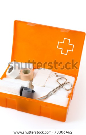 Open first aid kit isolated on white background - stock photo
