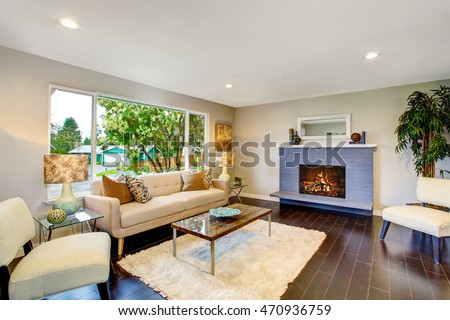 Open floor plan. Cozy living room interior with fireplace and hardwood floor. Northwest, USA