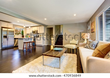 Open floor plan. Cozy living room interior with hardwood floor connected to kitchen. Northwest, USA