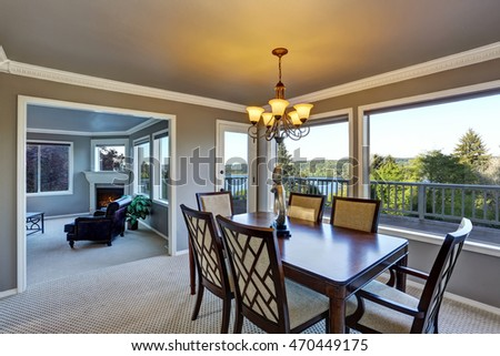 Open floor plan dining area with perfect water view through windows. Northwest, USA