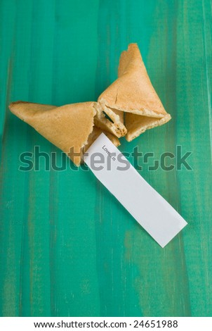 Open fortune cookie with message about love - stock photo