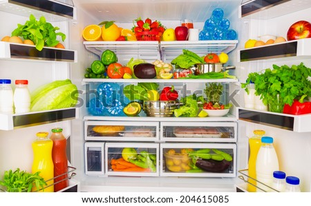 Open fridge full of fresh fruits and vegetables, healthy food background, organic nutrition, health care, dieting concept - stock photo