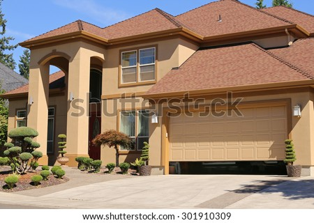 Open garage door in suburban family home - stock photo