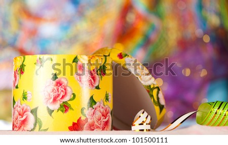 open gift box at bright holiday background - stock photo