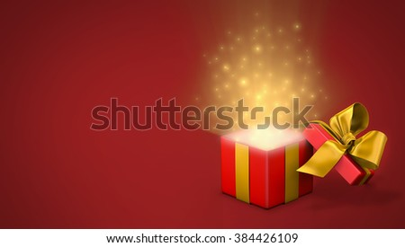 Open gift box with bright rays of light