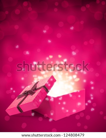 open gift box with light - stock photo