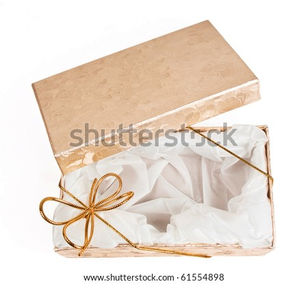 Open gift boxes with gold ribbon isolated on white background - stock photo