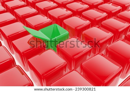 Open green box between group of red boxes - stock photo