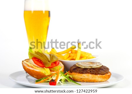 Open hamburger with beer and french fries - stock photo