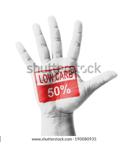 Open hand raised, Low Carbohydrate 50% sign painted, multi purpose concept - isolated on white background - stock photo