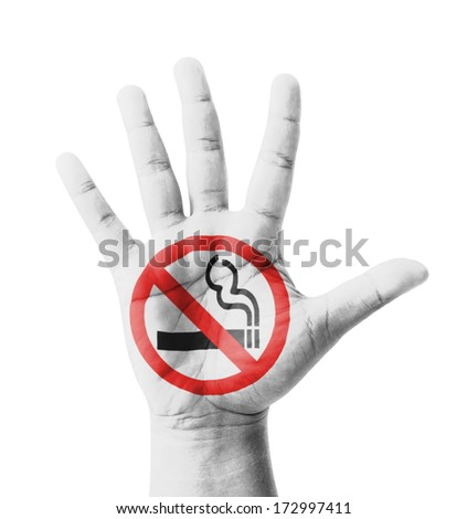 Open hand raised, No Smoking sign painted, multi purpose concept - isolated on white background - stock photo