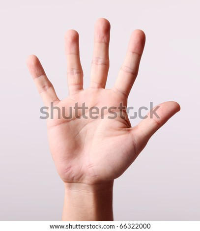 Open hand showing all five fingers. Background - stock photo