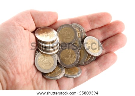 Open hand showing several euro coins isolated on white