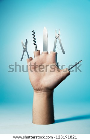 Open hand with tools on a blue background - stock photo