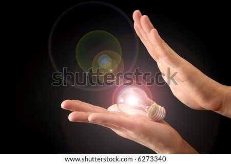 open hands holding shining lamp - stock photo
