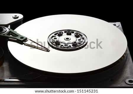 Open hard disk drive showing the read write arm and platter - stock photo