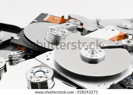 Open hard drives in bulk - stock photo