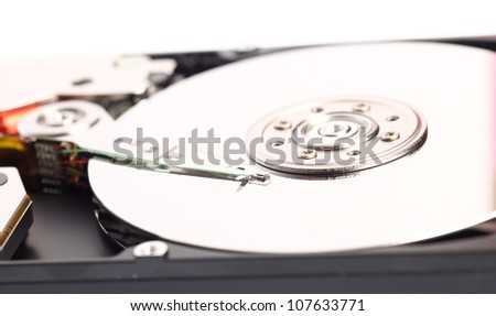 Open harddisk isolated on white background closeup of hard disk drive - stock photo