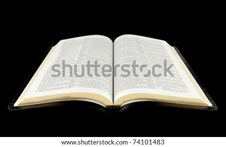 open Holy Bible isolated on black