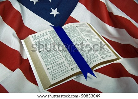 open holy bible on flag