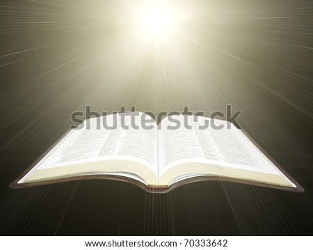 open Holy Bible with rays of light - stock photo
