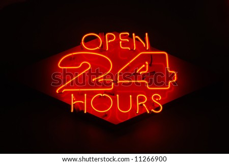 Open 24 Hours neon sign on a restaurant - stock photo