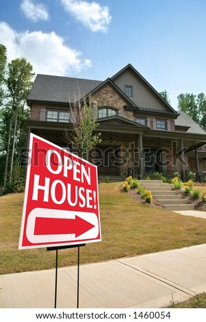 Open house sign in front of a new home - stock photo