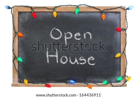 Open House written in white chalk on a black chalkboard surrounded with colored lights isolated on white - stock photo