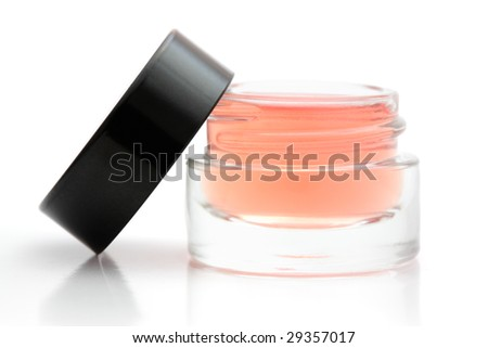 Open jar of cosmetic product isolated on white