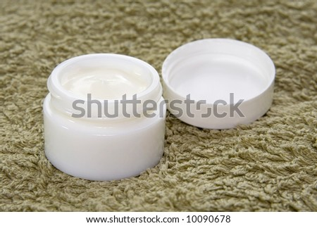 Open jar of cosmetics cream. Health and beauty.