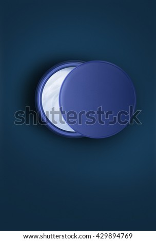 Open jar with night cream. Skin care creative concept. Top view - stock photo