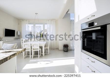 Open kitchen and dinning room in luxury villa - stock photo