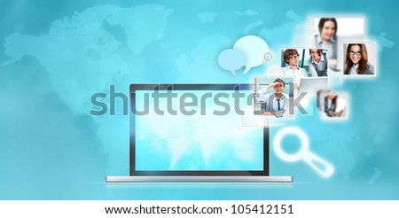 Open laptop at blue background. Pictures are flying out of the screen - stock photo