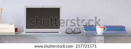 Open laptop computer with empty screen at desk in office (3D Rendering) - stock photo