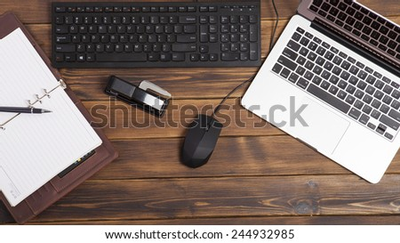 Open laptop on wooden table  - stock photo