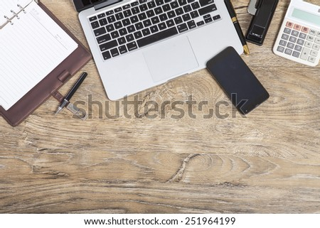 Open laptop on wooden table  - stock photo