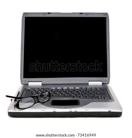 Open laptop with classes on keyboard. Laptop is facing viewer for inserting text on screen.