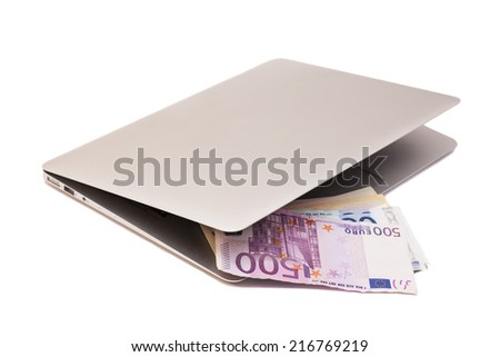 Open Laptop With Dollars And Euro money - stock photo