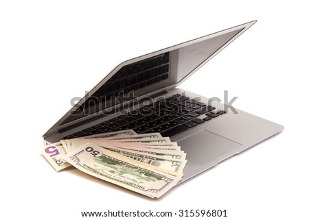 Open Laptop With Dollars money isolated - stock photo
