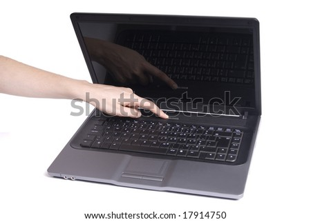 open laptop with hand turning it on