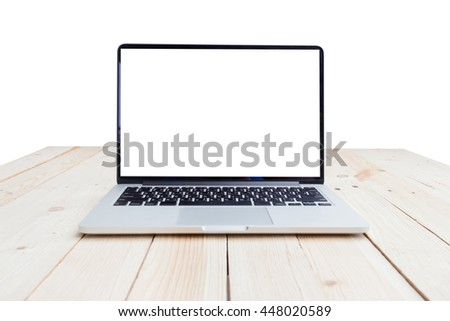 Open laptop with isolated white screen on old wooden desk