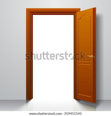 Open light brown door in white wall - stock photo