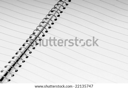 Open lined spiral bound notebook - stock photo