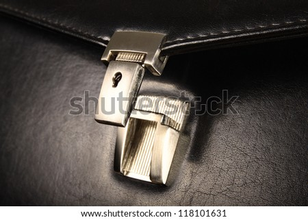 Open lock on leather business case - stock photo
