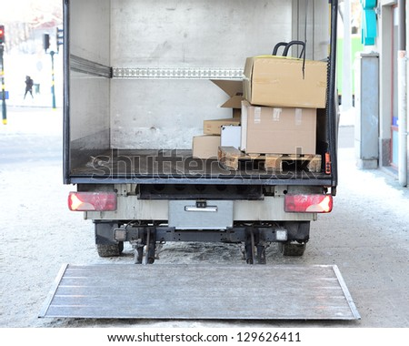 Open lorry truck loading or unloading - stock photo