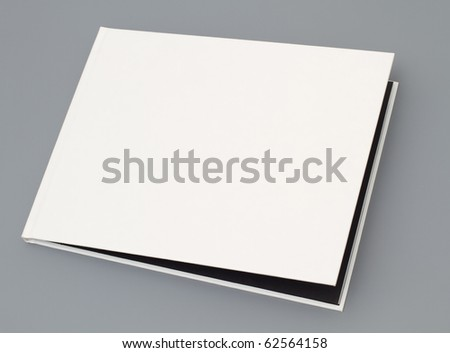 Open magazine's page on gray background - stock photo