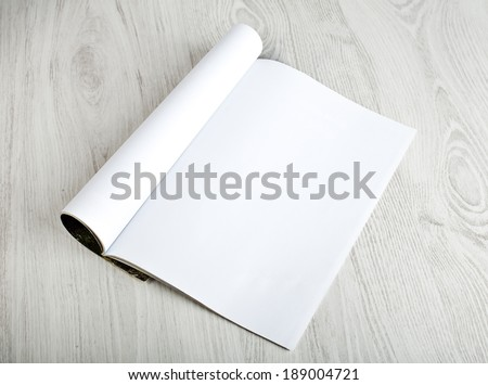Open magazine with blank pages - stock photo