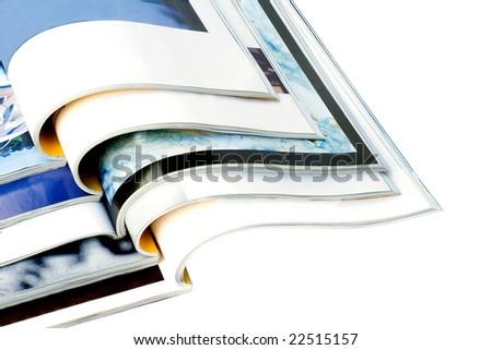 Open magazines isolated on white background - stock photo