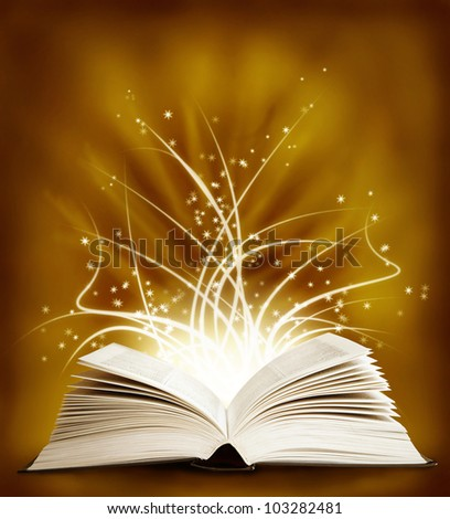 Open magic book on a dark background and lights