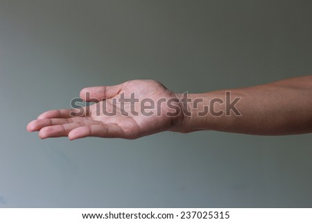 Open man hand is giving something - stock photo